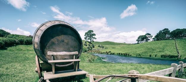 Wine barrel in green grass field in vintage tone