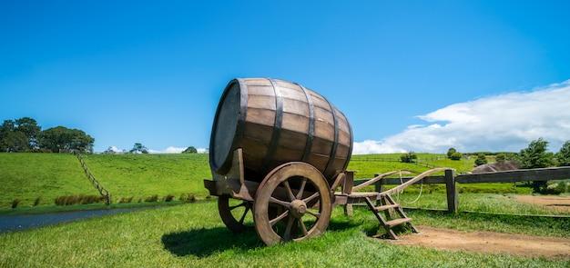Wine barrel in green grass field