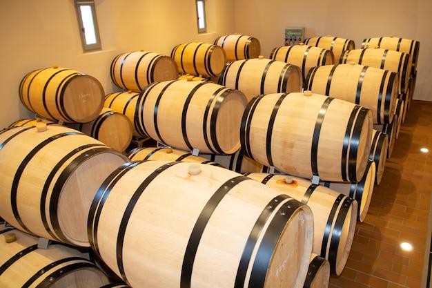 Wine barrels in cellar in bordeaux winery