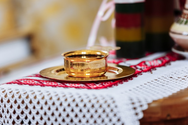 Wine, the blood of god in the cup before the wedding ceremony in the church. divine liturgy