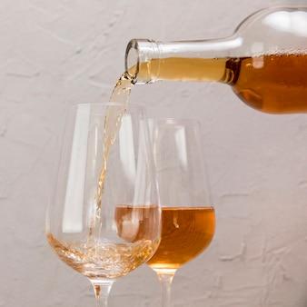 A wine bottle filling wineglass