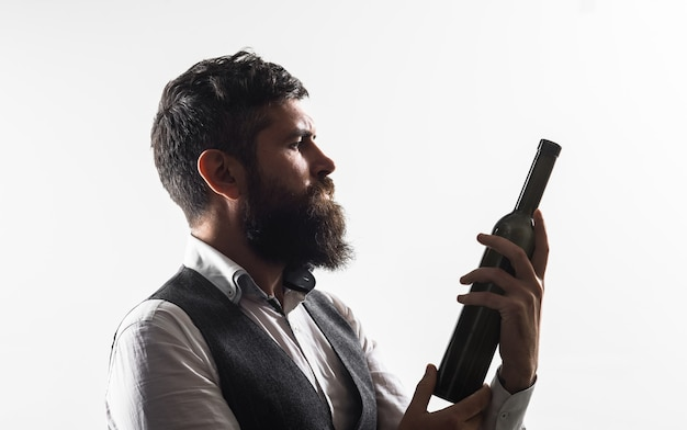 Wine bottle winetasting tasting alcohol red wine sommelier with red wine bearded man with glass of