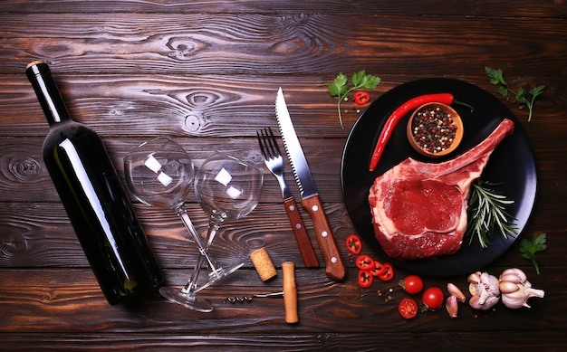 Wine bottle with beef steak with spices