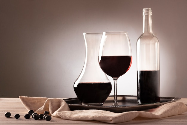 Wine bottle with glass and carafe Premium Photo