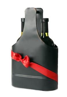 Бутылки вина в подарочной коробке на белом фоне
