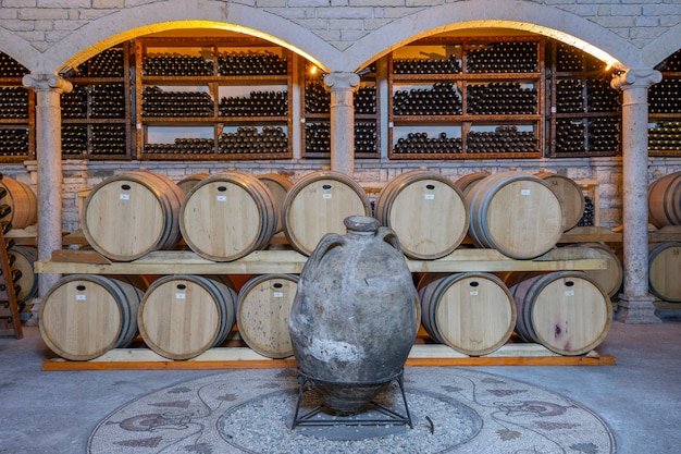 Wine cellar with barrels and bottles