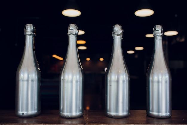 Wine champagne bottles silver on wooden shelf liquor store