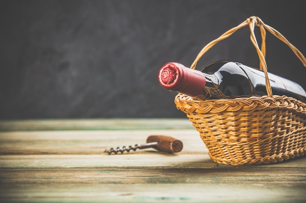 Wine composition on dark rustic background, space for text