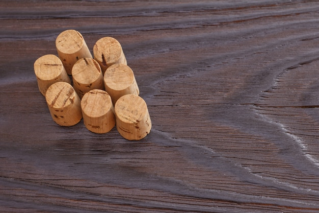 Wine cork on a wooden background. copy space. bunch of grapes