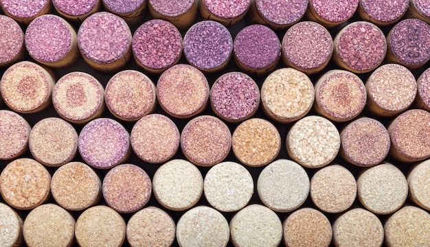 Wine corks from white and red wine arranged in rows by color