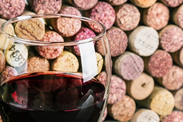 Wine corks through a glass of red wine