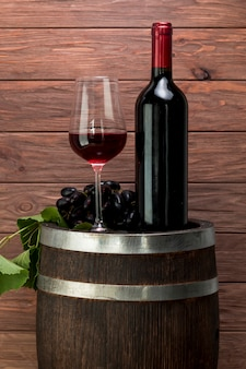 Wine glass and bottle on a barrel