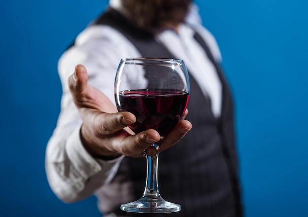 Wine glass close up bearded man with glass of wine tasting alcohol red wine man with alcohol man