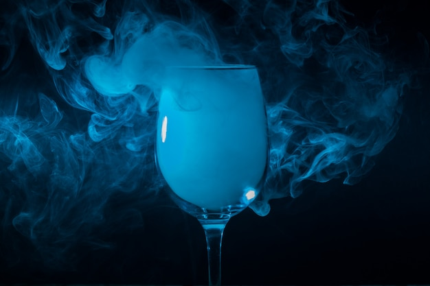 Wine glass filled with smoke