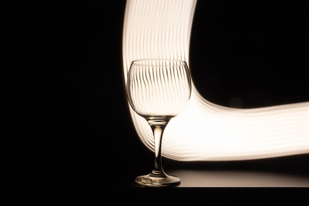 Wine glass and lights in the background