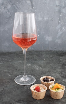 Wine glass rose wine  tartlet creamy goat cheese dried fruit appetizer
