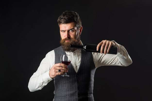 Wine glass tasting alcohol red wine bearded man with glass of wine man drinks red wine man with