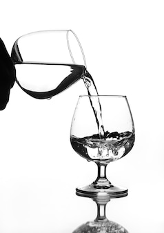 Wine glass water pouring to wine glass