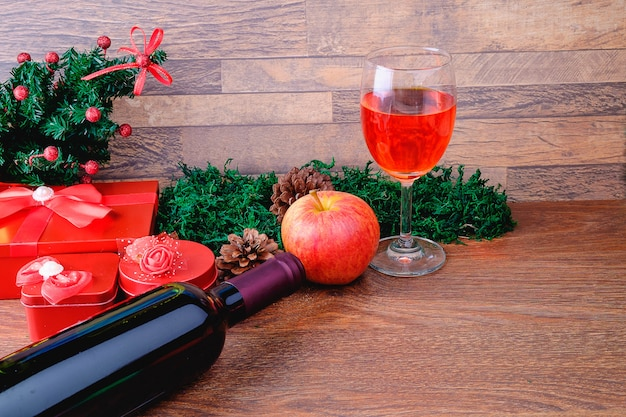 Wine glass and wine bottle with christmas gift box