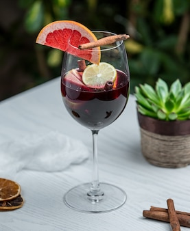 Wine glass with cinnamon grapefruit and other fruits