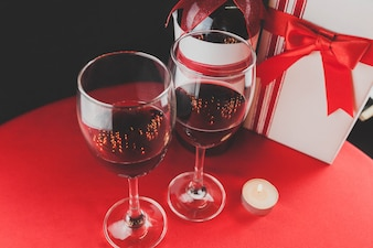 Wine glasses and a lit candle seen from above