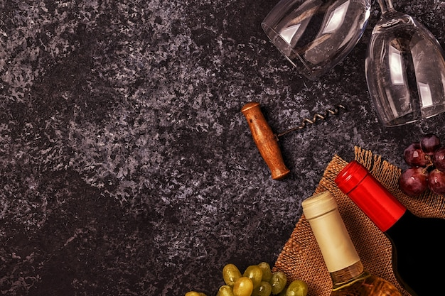 Wine, glasses, grapes and corkscrew
