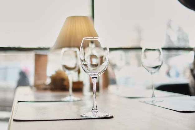 Wine glasses on table. many glasses ready to serve drinks at a party. business dinner.