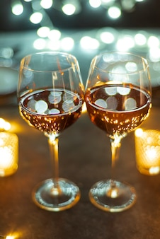 Wine glasses on a table with bokeh background