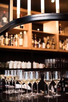 Wine glasses in warm light loft restaurant