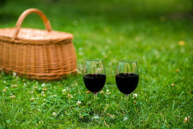 Wine glasses with a basket in the background
