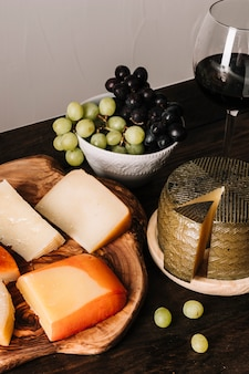Wine near grapes and cheese