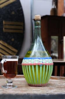 Wine in old bottles on a barrel