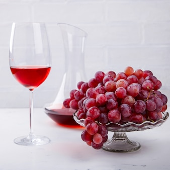 Wine pink and grape bunch. alcoholic drink in a glass