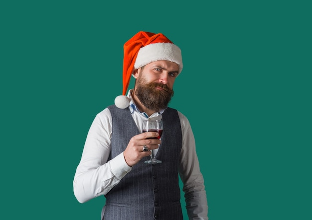 Wine santa drinking red wine man with alcohol bearded man with glass of wine man drinks red wine
