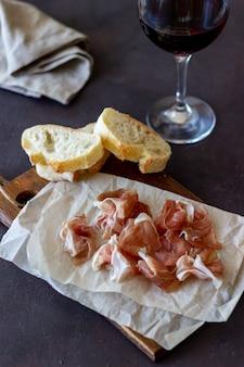 Wine snack. prosciutto, baguette. antipasti. wine appetizer.