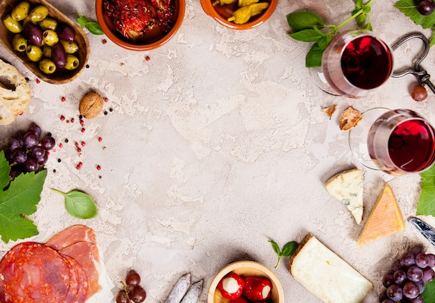 Wine and snack set on rustic background