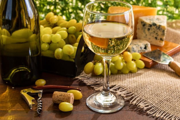 Wine table with cheese and grapes