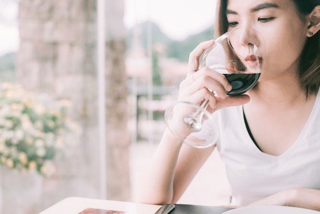 Wine tasting tourist woman.young woman drinking wine in italian style restaurant