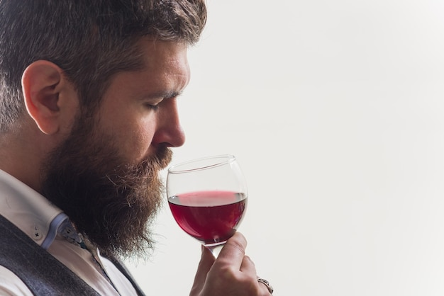 Wine. wine degustation. man with alcohol. bearded man with glass of wine. man drinks red wine. man with bordeaux.
