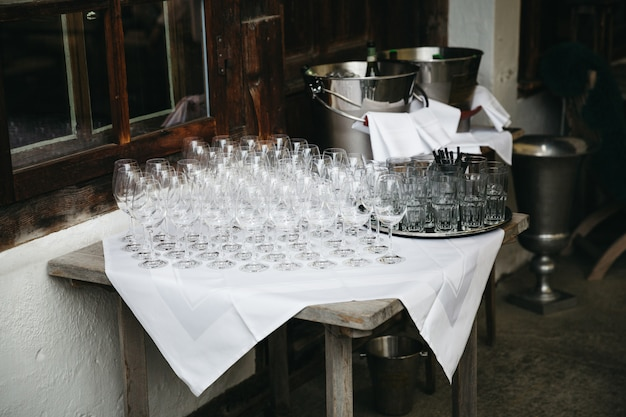 Wineglasses stand on a table before a restaurant