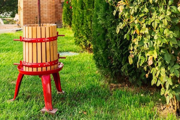 Winepress crusher machine for grape harvest winemaking outdoors