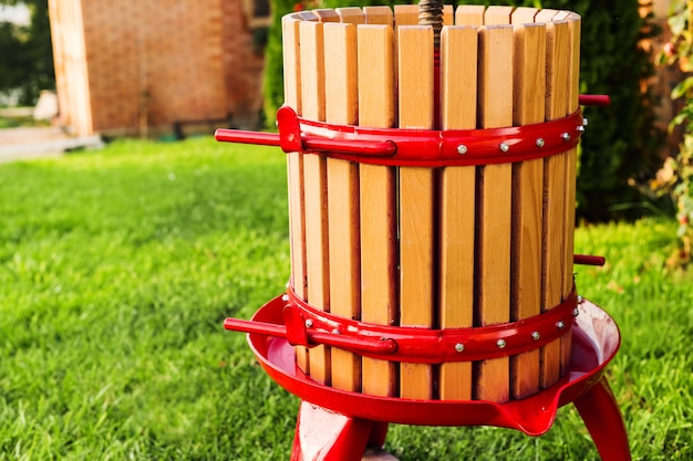 Winepress machine, crusher. grape harvest. special equipment for the production of wine, winemaking outdoors