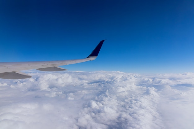 Wing aircraft in altitude during airplane flying above the clouds