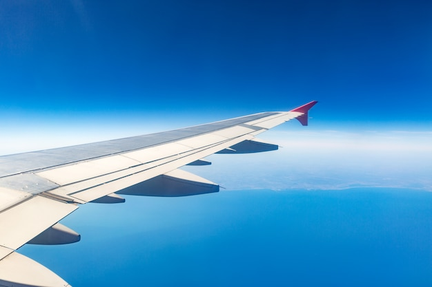 Wing of an airplane. traveling concept. aircraft wing on the clouds