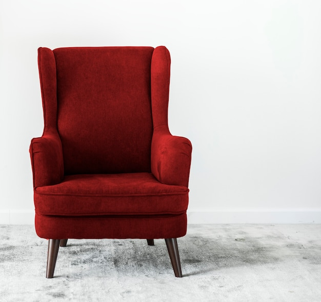 Wing back chair on a carpet no people