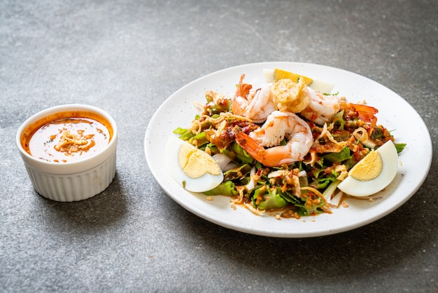 Wing bean or betel nuts spicy salad with prawns and shrimps