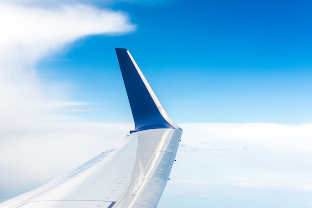 Wing of blue airplane in the air