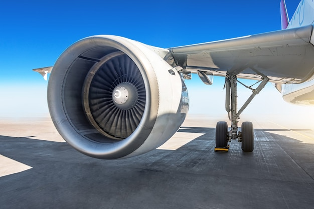 Wing jet engine of the airplane at the airport apron.