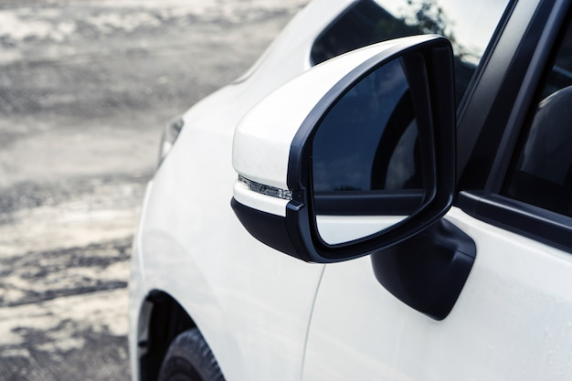 Wing mirror on the white car