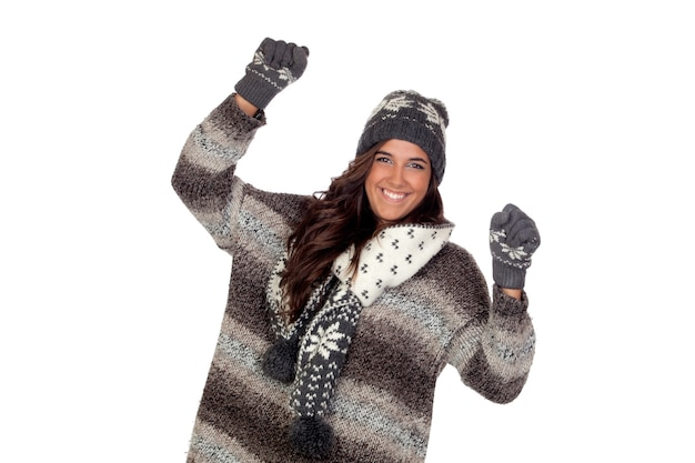Winner girl dressed in winter clothing isolated on a over white
